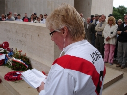 O's supporter Theresa Burns reads a war poem